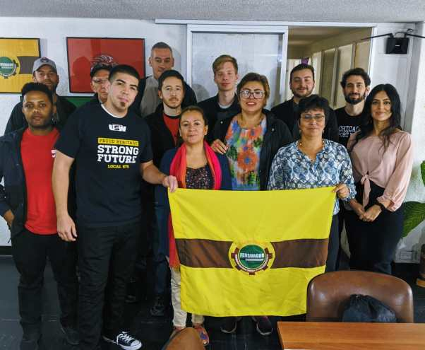 Nury Martinez (holding flag in red scarf) with members of Fensuagro, US Labor Against the War, and AFGJ