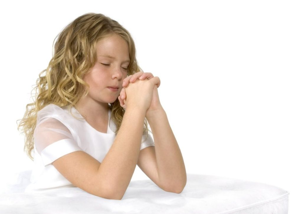 girl praying white iStock_000003842364Medium