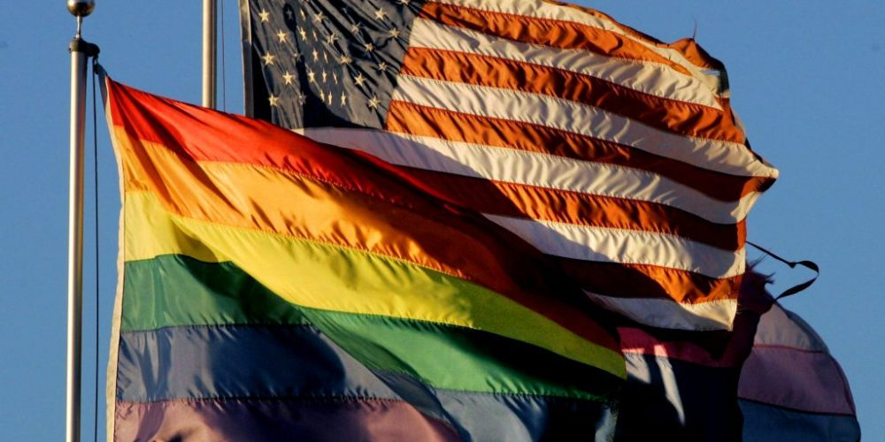 SAN DIEGO, CA - NOVEMBER 5:  An American flag flies next to a Rainbow flag at the San Diego Lesbian Gay Bisexual Transgender Community Center November 5, 2008 in San Diego, California.  Proposition 8, which bans same sex marriage, passed in yesterday's Calfironia election.  (Photo by Sandy Huffaker/Getty Images)
