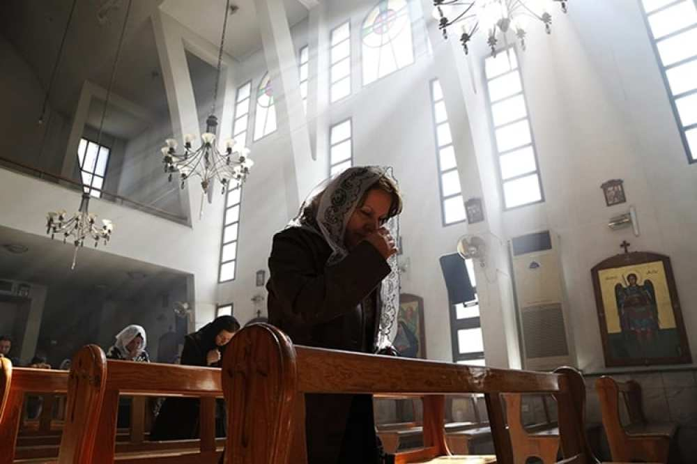 An Assyrian woman attends a mass in solidarity with the Assyrians abducted by Islamic State fighters in Syria earlier this week, inside Ibrahim al-Khalil church in Jaramana, eastern Damascus on March 1, 2015. Photo courtesy of REUTERS/Omar Sanadiki *Editors: This photo may only be republished with RNS-SEIPLE-COLUMN, originally transmitted on July 7, 2015.