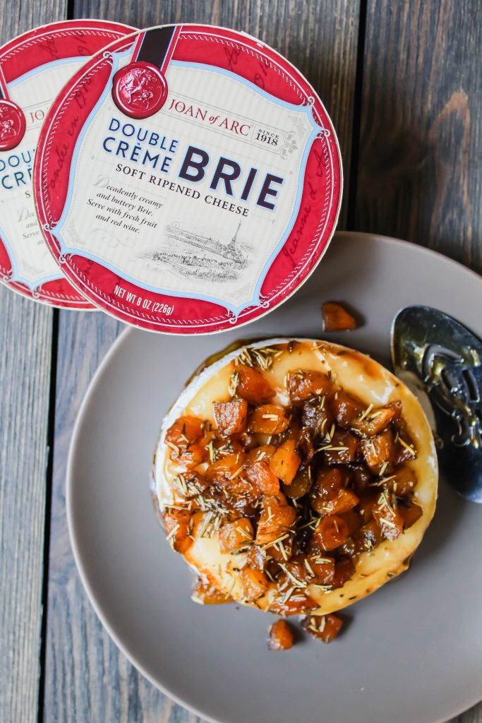 gorgeous baked brie topped with apricots, herbs, and balsamic. a fun twist on an elegant classic holiday dish.