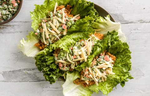 Green leaf lettuce filled with shredded grilled buffalo chicken, shredded cheese, and a creamy ranch slaw.