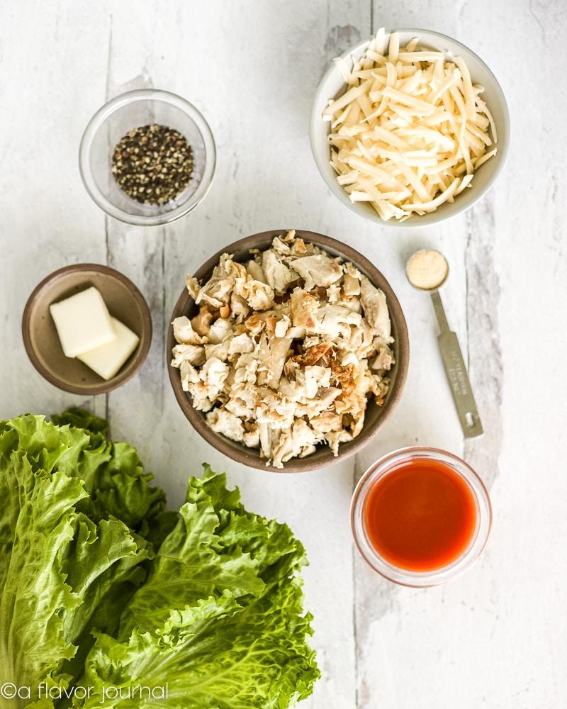 Ingredients for shredded buffalo chicken lettuce wraps.