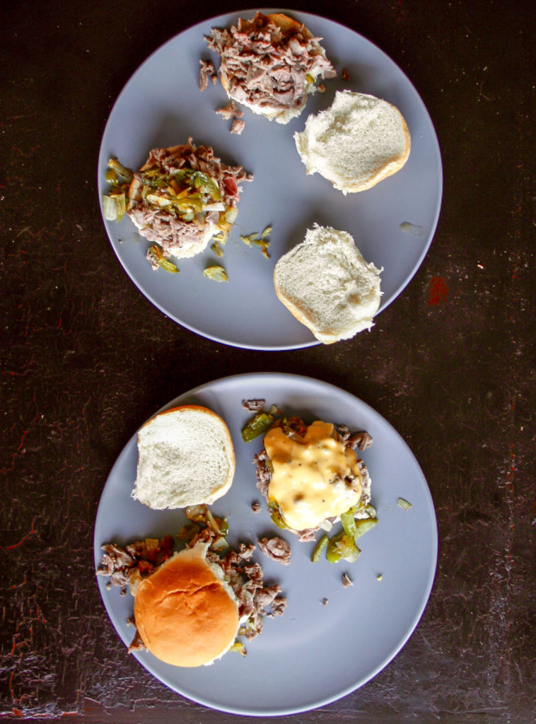philly cheesesteak sliders are a little spicy and so delicious! Made with sautéed ribeye, green pepper, onion, jalapeño, and topped with cheese sauce!