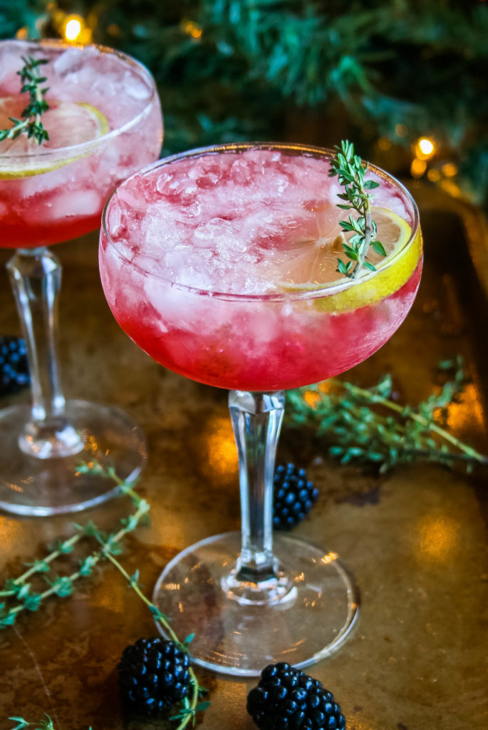 fresh blackberries, lemon juice, and thyme-infused simple syrup are combined with bourbon for this refreshing blackberry, thyme, and lemon bourbon cocktail. blackberry, thyme, and lemon bourbon cocktail | a flavor journal food blog