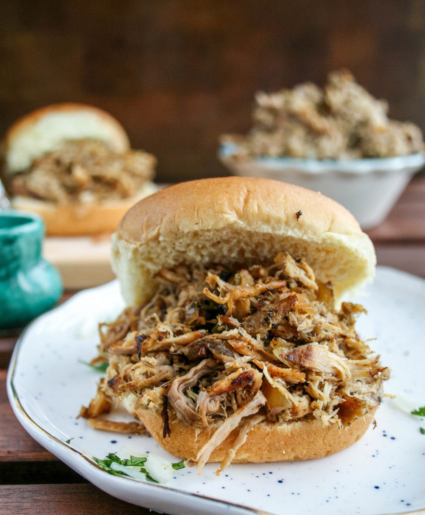 pork carnitas sliders are easy to make and packed with flavor! perfect for any game day or celebration, these sliders are going to kill it. top them with creamy sauce, onions, cilantro, or anything! | a flavor journal