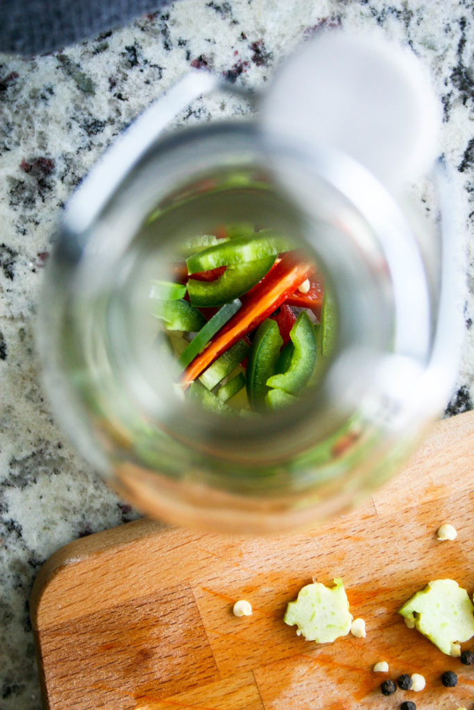 spicy peppers, garlic, and black peppercorns are infused into vodka to create an awesome vodka infusion for bloody mary cocktails! hot pepper infused vodka : a flavor journal | food blog.