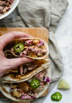 perfectly flaked white fish and crunchy red cabbage slaw are tossed in a cool and creamy sauce for easy and super delicious fish tacos. fish tacos with crunchy slaw   a flavor journal food blog