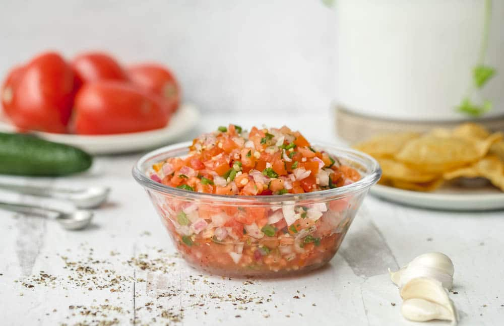 A fresh and easy pico de gallo recipe (with garlic) that is a perfect topping for any Mexican dish!