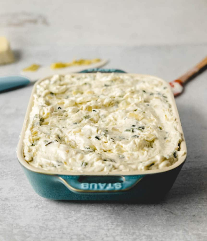 Roasted jalapenos and chopped artichoke hearts mixed with a creamy, cheesy blend for the best artichoke dip!