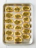 Crunchy crostinis with basil pesto