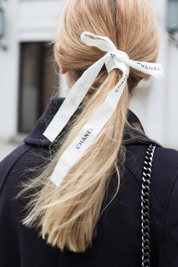Girl with Chanel ribbon in the hair