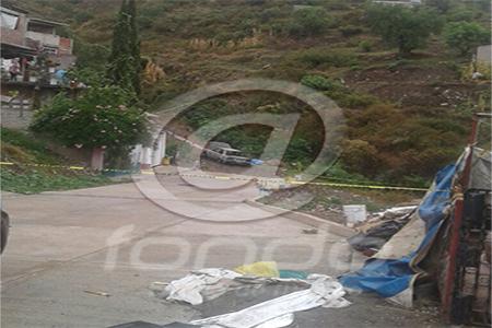 El cuerpo y el auto fueron trasladados a Neza.