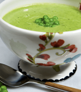A bowl of bright and fresh pea soup.