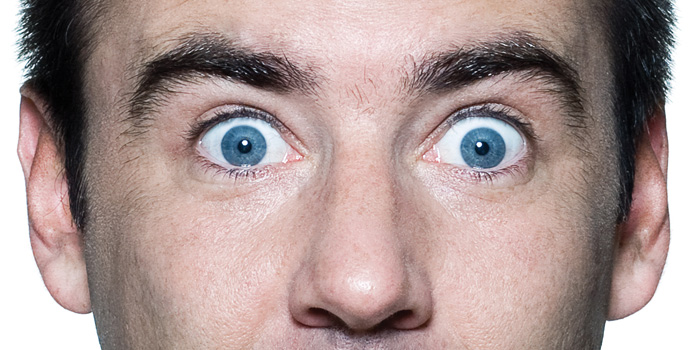 A man with wide open eyes
