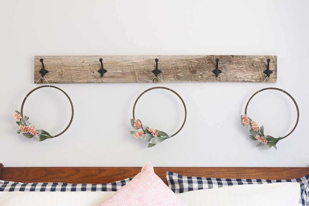 I wanted to fill the space above my headboard with some wreaths and I needed a hook board to hang them.Let me show you how to make a wall mounted hook rack. HOW TO MAKE A WALL MOUNTED HOOK RACK