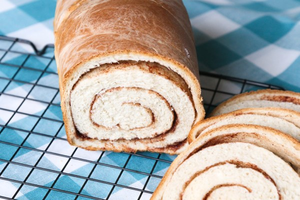 When we talk about family favorites this one is at the top of the list. Swirled Cinnamon Bread is made over and over in my home and it doesn't last long! SWIRLED CINNAMON BREAD
