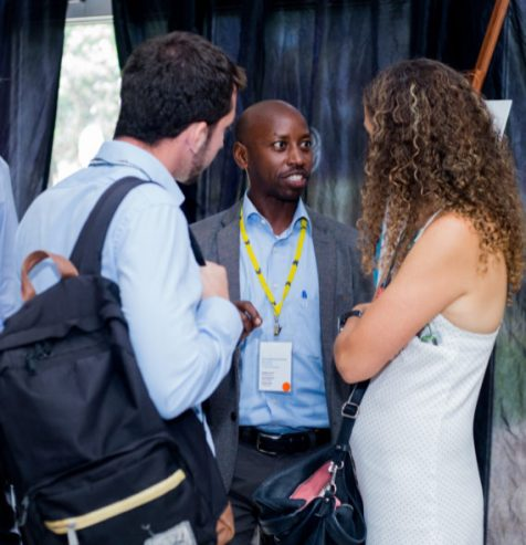 Alphonse Nkurunziza of Kigali chats with MOBILIZE participants in between sessions.