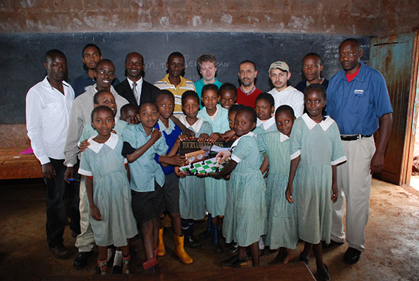 Dimitri and Nairobi Chess Club officials donating a chess set to Kabete Cares Chess Club