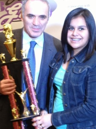 Claudia being awarded her trophy by Garry Kasparov