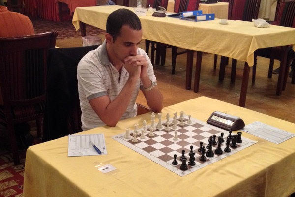 GM Bassem Amin waiting for his opponent during the Zone 4.2 Individual Chess Championships