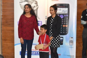 Yash Ritesh Shah (Under 8) receiving his prize from chess coach Latha Sathya and arbiter WFM Sanjana Deshpande / Photo by Sruthi Vasanth