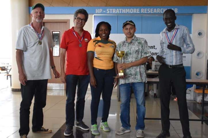 Team Nairobi Chess Club receiving their trophy from Strathmore University Sports Director Sylvia Kamau / Photo by Allan Rongoey