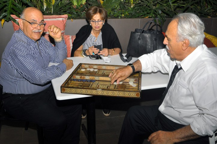 Village Market's Managing Director Hamed Ehsani (left), a backgammon enthusiast, plays with friends