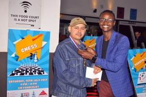 Mehul receiving his prize from Village Market's David Henry Ouma