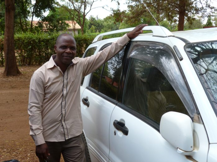 AfricAid's dependable driver, Oscar Changelela, ready to transport the Kisa Mentors to their daily classes.