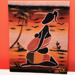 Woman sitting with baby on back - Sand Painting