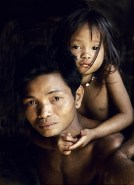 Indonesia. Borneo rain forest. Dyak manand daughter.