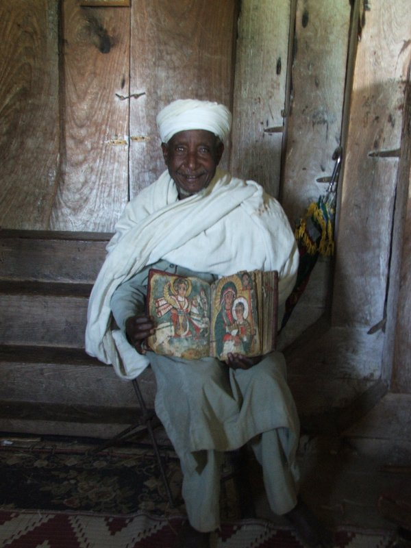 old-priest-with-a-parchment
