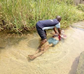 Ime Inuaeyen being baptized by Mojima Etokudo 2