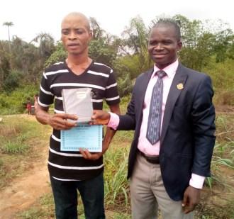 Mojima Etokudo presented a Bible & Baptismal Certificate