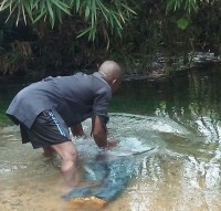 Ofonbuk Udom being baptized into Christ 2