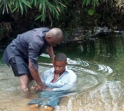 Ofonbuk Udom being baptized into Christ