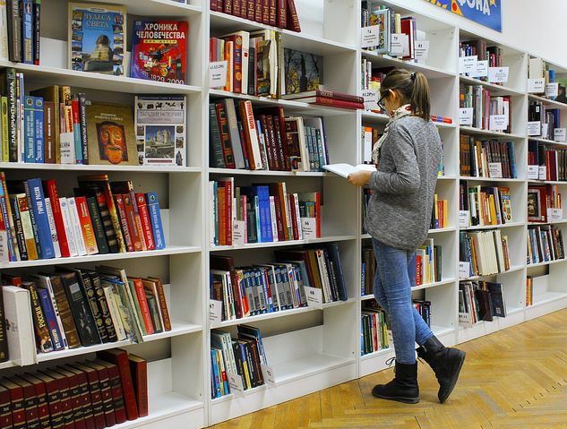 A Girl with a book in a library