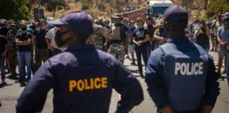 South Africa white farmers, Black protesters face off over farm murder case