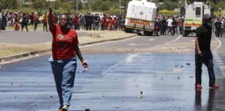 Police use tear gas on protest over race in South Africa