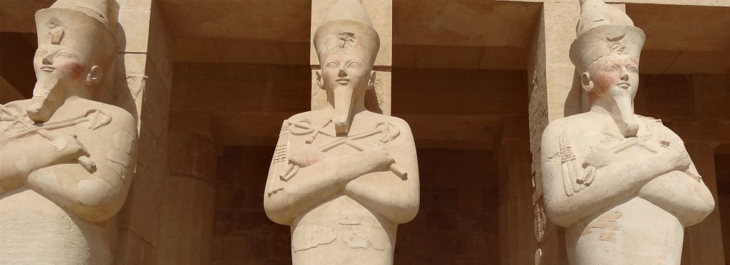 statues at temple of hatshepsut, egypt
