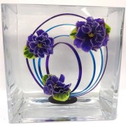 Closeup of underwater design using three purple violet blossoms and loops of wire