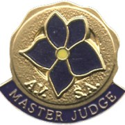 """Master Judge Lapel Pin with deep purple enameled violet blossom and the words """"AVSA Master Judge"""" below"""