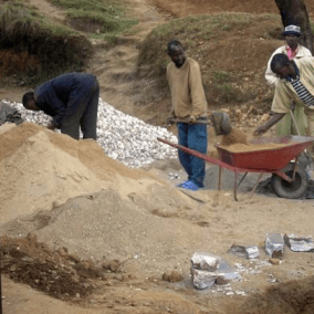 men working on the rwandan well