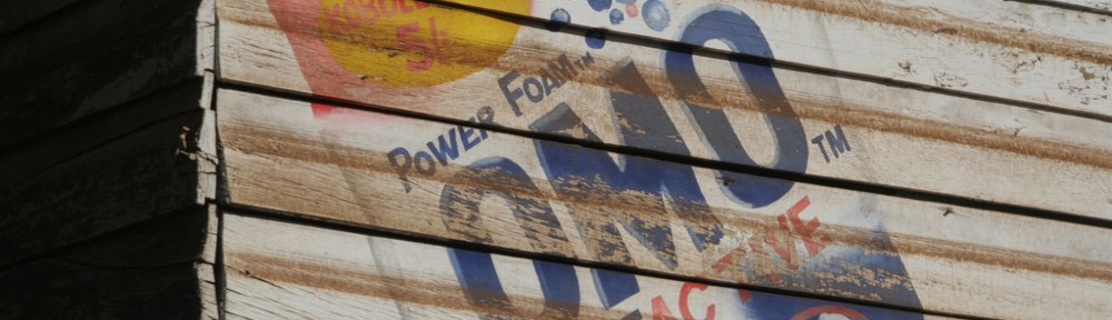Kenya advertising sign painted on wood building for Omo multiactive power foam cleaner