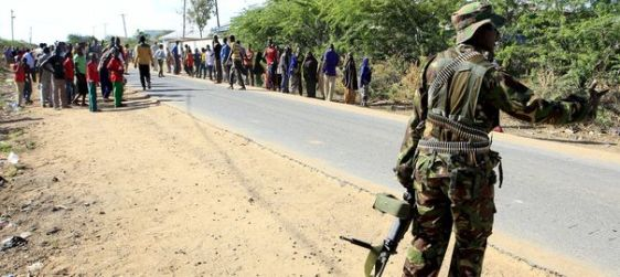 a-kenya-defense-force-soldier-keeps-residents-at-bay-to-prevent-them-from-moving-in-the-direction-where-attackers-are-holding-up-at-a-campus-in-garissa_5313711