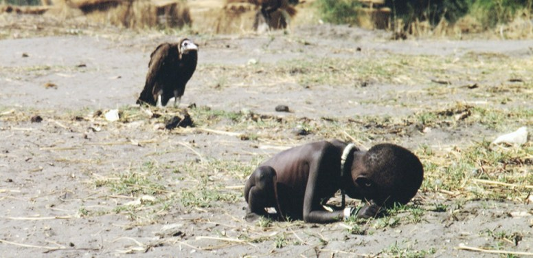 March 1993, Sudan --- Vulture Watching Starving Child --- Image by © Kevin Carter/Sygma/Corbis