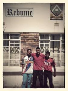 Ryno Botes, Winston van Rooi & Percy Cyster checking into their new hostel