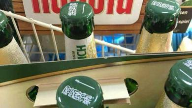 Germany: Brewery company print Saudis banner on beer bottles