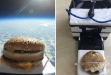 Soccer players find box from space with hamburger on the field